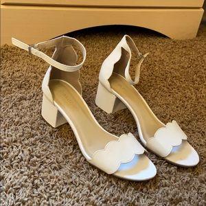 White scalloped heels